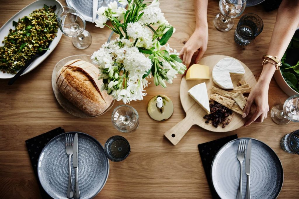 Table of food with cheese platter and sourdough