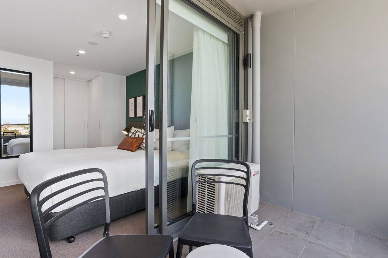 King bed and balcony at The Sebel Moonee Ponds