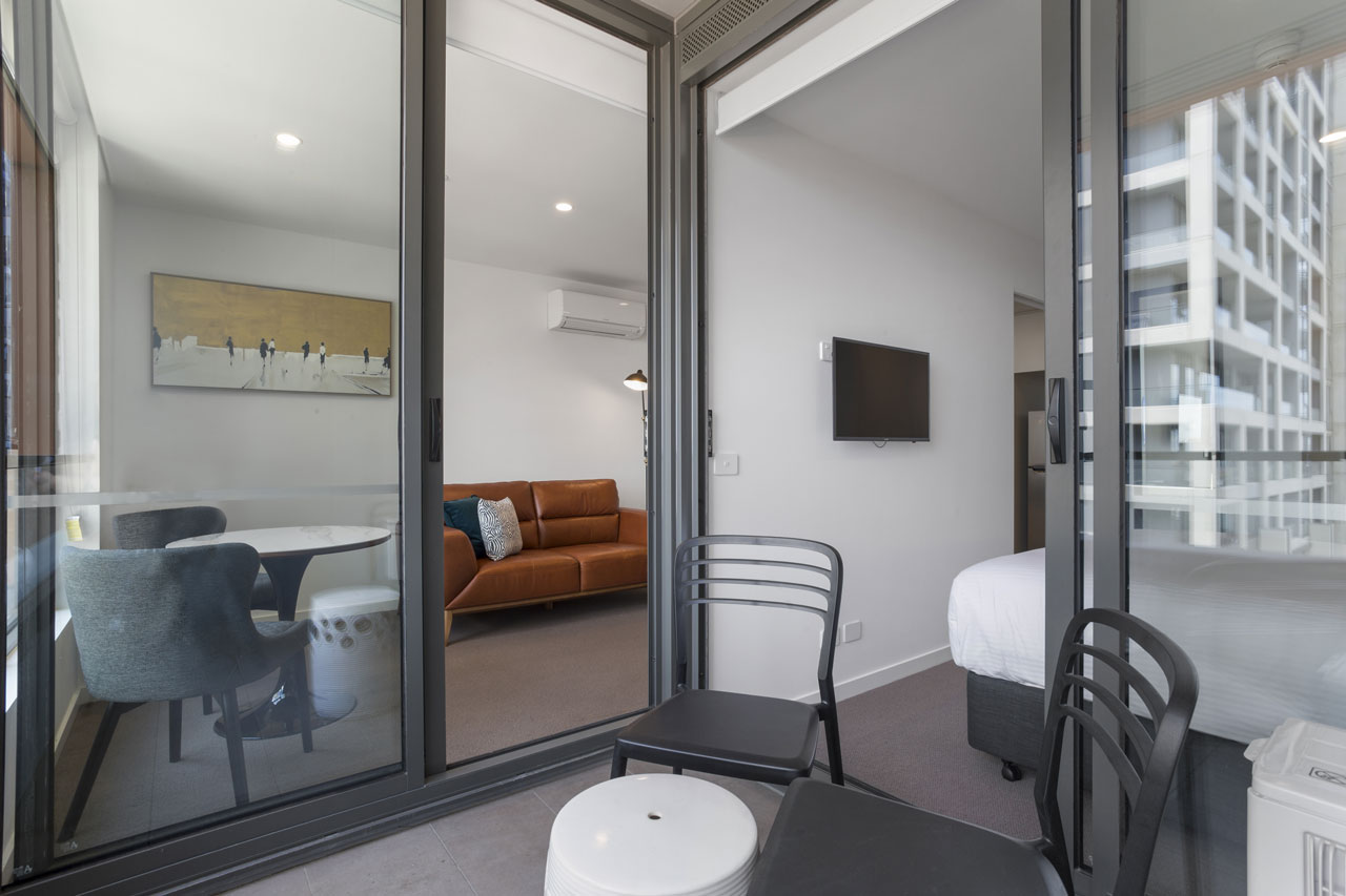 Lounge room and balcony at The Sebel Moonee Ponds