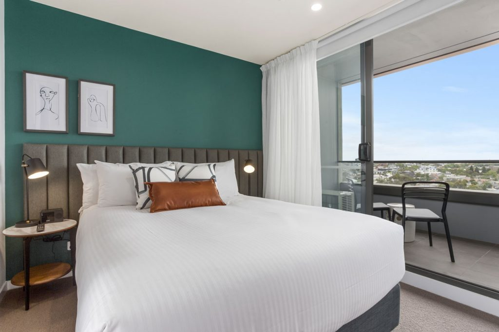 queen bed and balcony at The Sebel Moonee Ponds