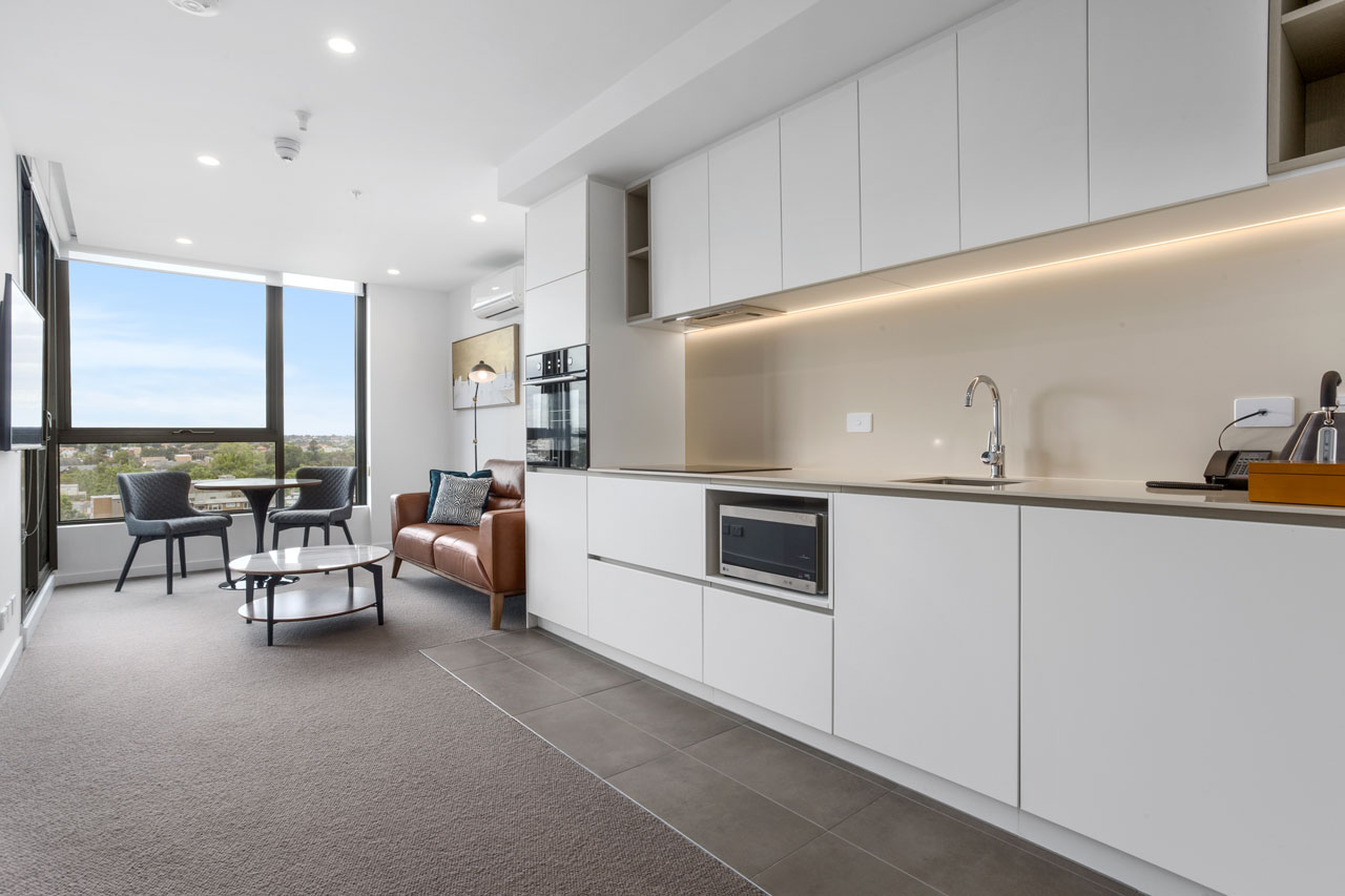 Kitchen and dining at The Sebel Moonee Ponds in 1 bedroom apartment with queen bed