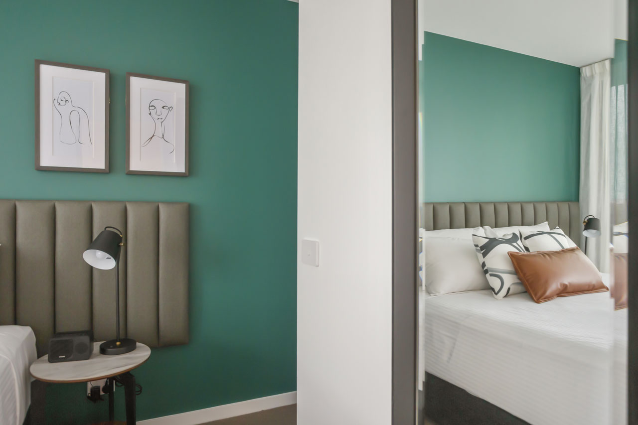 Mirror and King bed at The Sebel Moonee Ponds