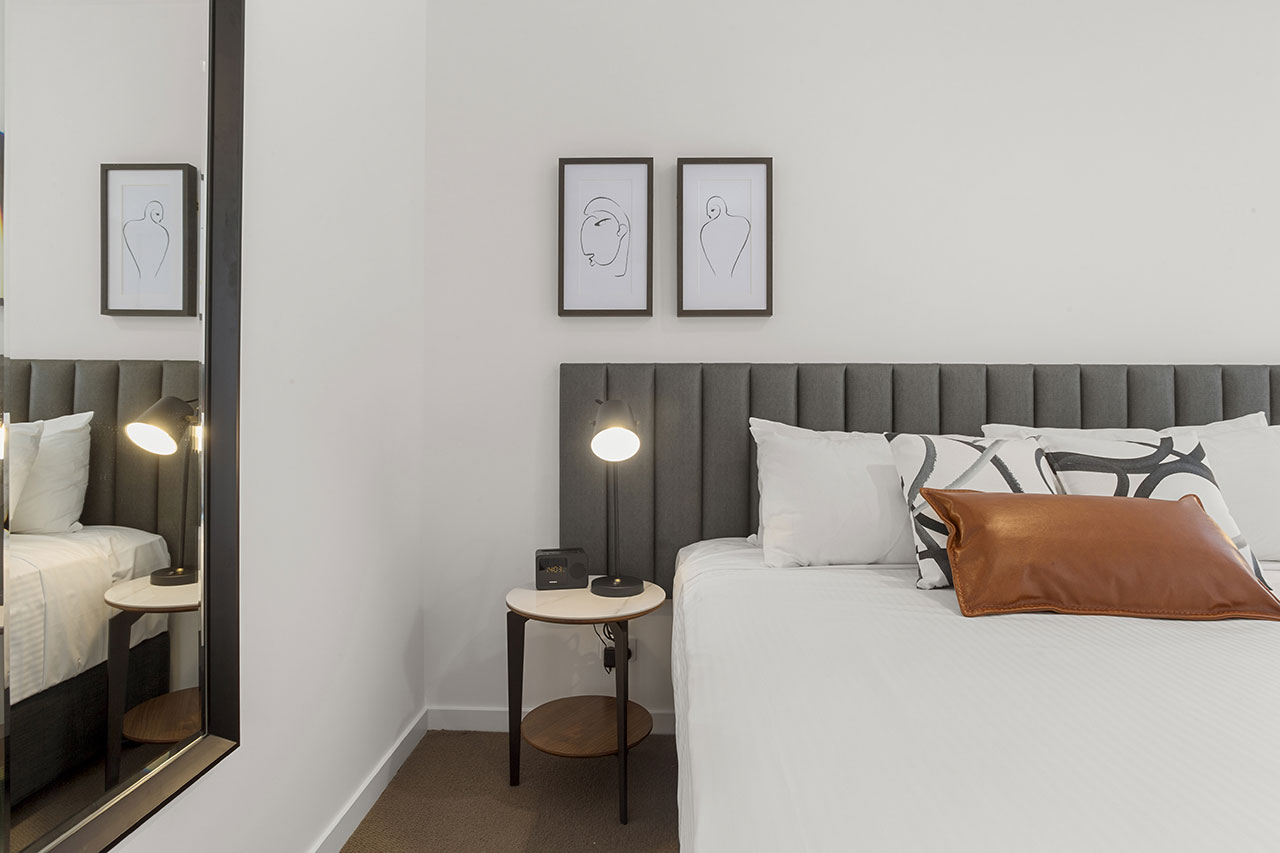 King bed and bedside table at The Sebel Moonee Ponds